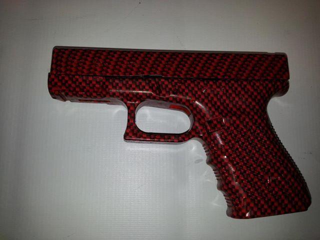 pistola fibra de carbono rojo pintura hidrografia